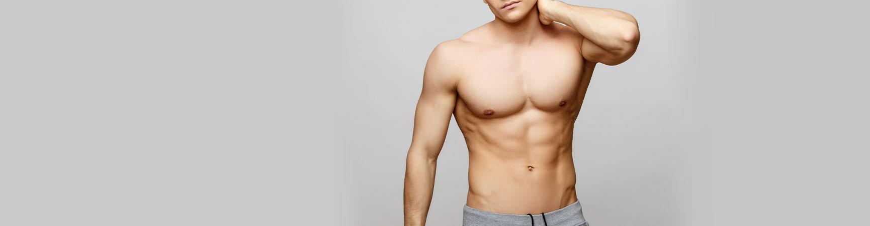 male model posing showing torso musles