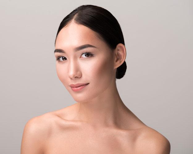 woman smiling displaying facial contours