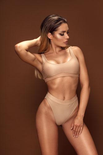 model posing showing full body curves