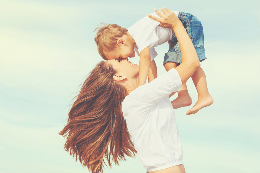 mother holding child over head